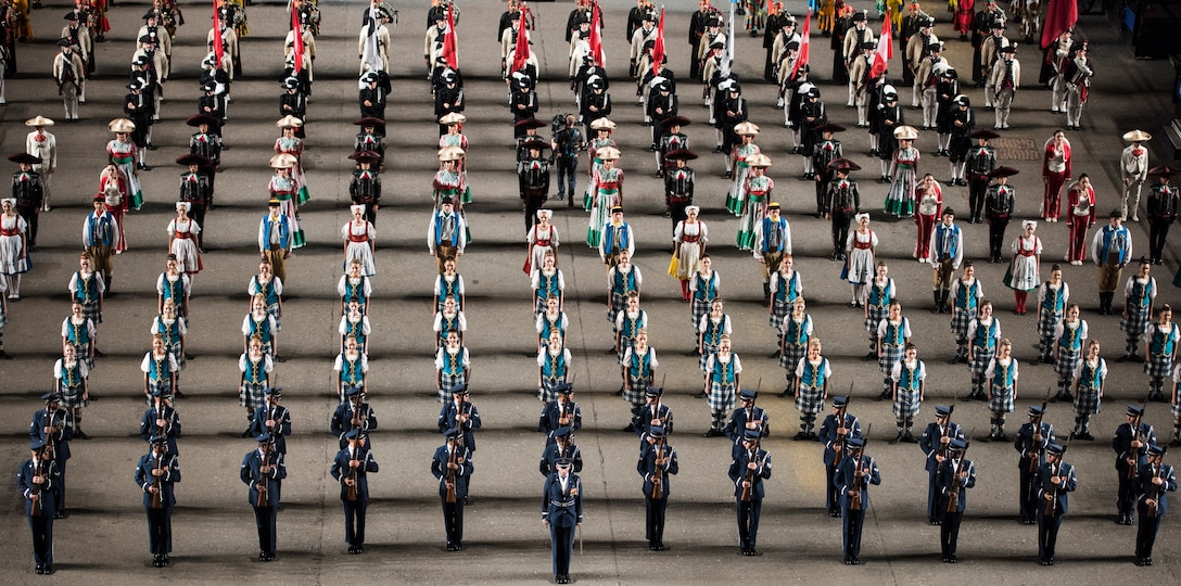 The U.S. Air Force Honor Guard Drill Team performs during the Royal Edinburgh Military Tattoo, with other performers, on the Esplanade of the Edinburgh Castle in Edinburgh, Scotland, Aug. 14, 2018. The Tattoo is a global gathering of differing talents and performers from every corner of the globe, allowing each participating country to display pride in their military power and culture. (U.S. Air Force photo by Airman 1st Class Michael S. Murphy)