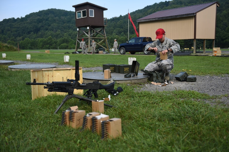U.S. Air Force Tech. Sgt. Rickelle Groover, Combat Arms Training and Maintenance Instructor, prepares a weapons range for use at Camp Dawson, W. Va., Aug. 6, 2018. Groover and other guardsmen from the 171st Security Forces Squadron, located at the 171st Air Refueling Wing near Pittsburgh, traveled to Camp Dawson, August 5-8, 2018, to familiarize and qualify on the 240B and 249 machine guns. (U.S. Air National Guard photo by Tech. Sgt. Allyson L. Manners)
