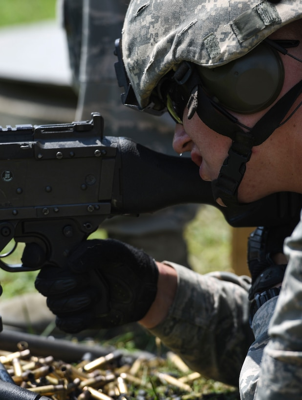 U.S. Air Force Airman 1st Class Joshua Snyder, Security Forces Specialist, 171st Security Forces Squadron, fires a 249 machine gun during a weapons qualification at Camp Dawson, W. Va., Aug. 6, 2018. Guardsmen from the 171SFS, located at the 171st Air Refueling Wing near Pittsburgh, traveled to Camp Dawson, August 5-8, 2018, to familiarize and qualify on the 240B and 249 machine guns. (U.S. Air National Guard photo by Tech. Sgt. Allyson L. Manners)
