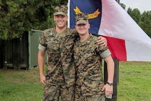 Marine Corps 2nd Lt. Zachary Bowman stands proud with his officer selection officer, Marine Corps Maj. Trey B. Kennedy, on graduation day at Officer Candidates School, Quantico, Va., Aug. 11, 2018. Bowman lost more than 40 pounds on his journey to become a Marine Corps officer. Bowman will pursue the military occupational specialty of judge advocate after Basic School. Courtesy photo