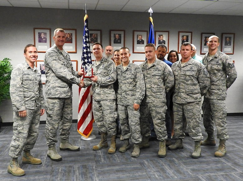 Here Colonel John Tryon AFCEC Operations Director, presents the APE Team the Joe Sciabica Teamwork Award for April to June 2018. It was also announced that the APE Team has received the General Mark Welsch III One Air Force Award for the entire Air Force.