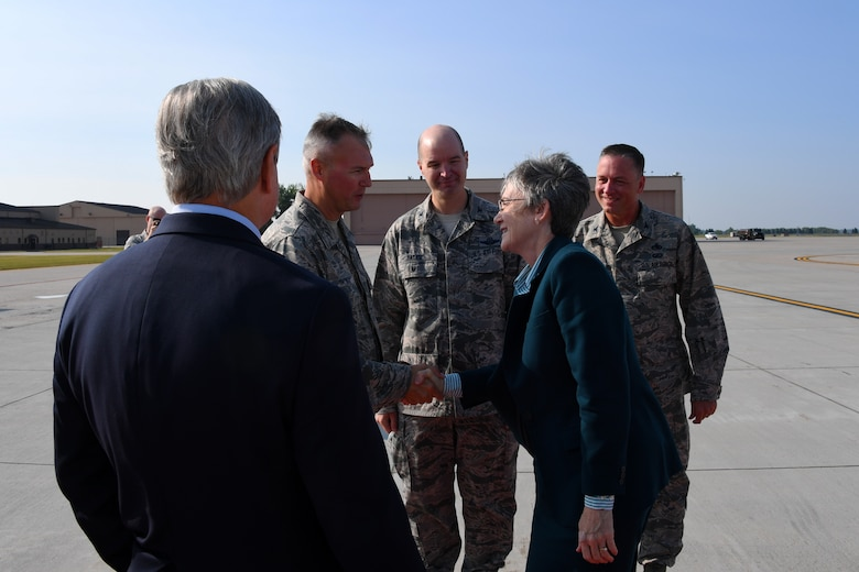 Secretary of the Air Force Heather Wilson is greeted by 319th Air Base Wing commander, vice commander and command chief, Col. Benjamin Spencer, Col. Bart Yates and Chief Master Sgt. Brian Thomas August 20, 2018, as she arrives to Grand Forks Air Force Base, North Dakota. Wilson spent the day in its entirety learning more about Grand Forks AFB through the eyes of base Airmen and leaders. (U.S. Air Force photo by Airman 1st Class Elora J. Martinez)