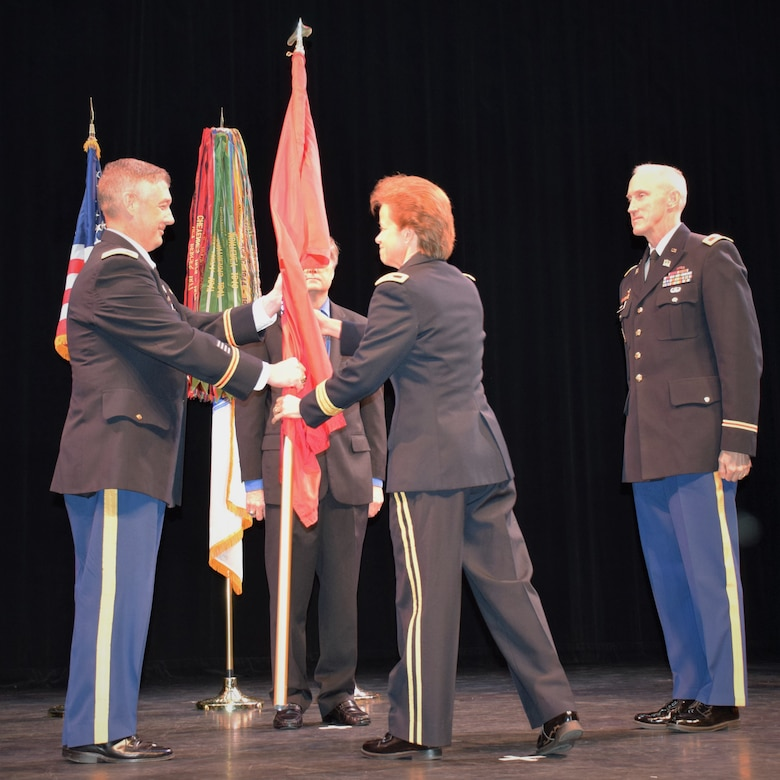U.S. Army Corps of Engineers, South Atlantic Division Commander Brig. Gen. Diana Holland passes the colors to incoming Commander Col. Andrew Kelly during today's Change of Command ceremony. The ceremony symbolizes the passage of responsibility from departing commander to his successor.