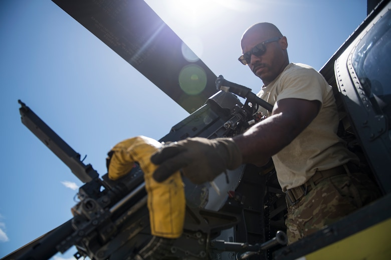 Tech. Sgt. Brandon Middleton, 41st Rescue Squadron (RQS) special missions aviator, inspects an M2 machine gun prior to a mission, Aug. 16, 2018, at Patrick Air Force Base (AFB), Fla. Airmen from the 41st RQS and 41st Helicopter Maintenance Unit traveled to Patrick AFB to participate in a spin-up exercise. During the exercise, Airmen faced scenarios and situations they may encounter downrange. (U.S. Air Force photo by Senior Airman Janiqua P. Robinson)