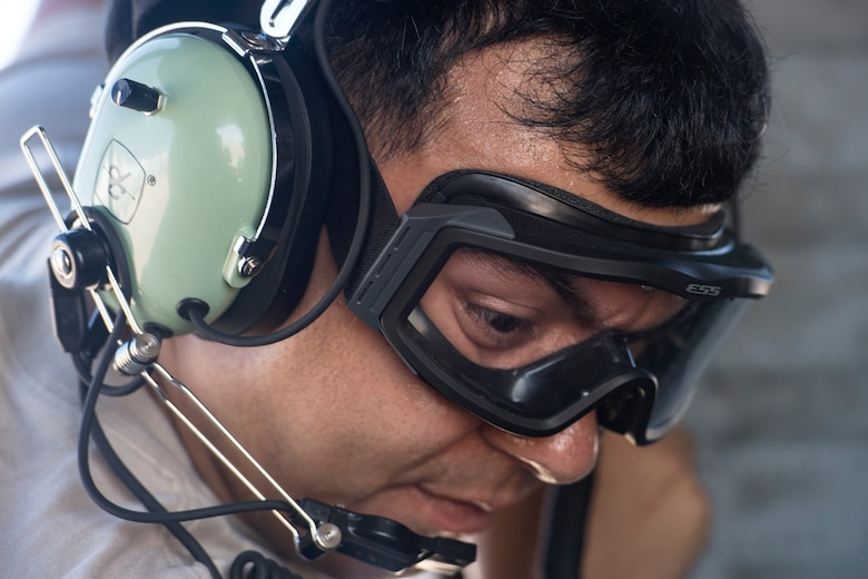 Senior Airman Jeremy David, 41st Helicopter Maintenance Unit (HMU) crew chief, performs the final checks before launching an HH-60G Pave Hawk, Aug. 17, 2018, at Patrick Air Force Base, Fla. Airmen from the 41st Rescue Squadron and 41st HMU traveled to Patrick AFB to participate in a spin-up exercise. During the exercise, Airmen faced scenarios and situations they may encounter downrange. (U.S. Air Force photo by Senior Airman Janiqua P. Robinson)