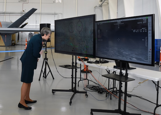 Secretary of the Air Force Heather Wilson looks at a display of movement of an unmanned aircraft system that took off from Grand Forks Air Force Base without the need for a chase plane to maintain visuals Aug 20, 2018. The new operation marked a milestone for the Grand Forks region, military, unmanned aircraft system business and national security. (U.S. Air Force photo by Senior Airman Cierra Presentado)