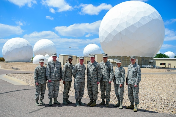 Team Buckley Champions stand in front of radomes July 30, 2018, on Buckley Air Force Base, Colorado. The Champions are the base's top leaders who spearhead objectives that strategically align with the wing's priorities. (U.S. Air Force photo by Airman 1st Class Jake Deatherage)