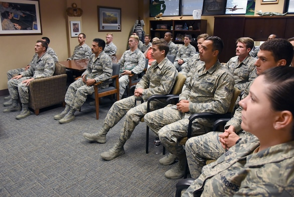 Airmen in the 334th Training Squadron watch a televised Medal of Honor presentation at Cody Hall at Keesler Air Force Base, Mississippi, Aug. 23, 2018. Tech. Sgt. John Chapman was posthumously awarded the Medal of Honor, the nation�s highest award for valor in combat, by U.S. President Donald Trump. Chapman was killed in Afghanistan on March 4, 2002. He attended the air traffic control course at Keesler in 1989. (U.S. Air Force photo by Kemberly Groue)