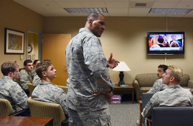 U.S. Air Force Lt. Col. Billy Wilson, 334th Training Squadron commander, speaks with Airmen after watching a televised Medal of Honor presentation at Cody Hall at Keesler Air Force Base, Mississippi, Aug. 23, 2018. Tech. Sgt. John Chapman was posthumously awarded the Medal of Honor, the nation�s highest award for valor in combat, by U.S. President Donald Trump. Chapman was killed in Afghanistan on March 4, 2002. He attended the air traffic control course at Keesler in 1989. (U.S. Air Force photo by Kemberly Groue)