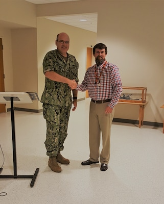 NSWC Crane Employee Toby Evans Recieves Medal of Valor, presented by CAPT Mark Oesterreich.