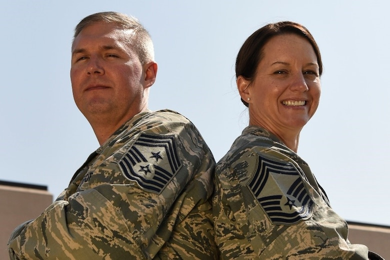 Chief Master Sgt. Brian Thomas, the 319th Air Base Wing command chief, and Chief Master Sgt. Shannon Thomas, the 69th Maintenance Squadron chief enlisted manager, stand outside for a photo on August 22, 2018, on Grand Forks Air Force Base, North Dakota. With more than 40 years of combined military service, B. Thomas and S. Thomas have experienced continuous growth in their career and family. (U.S. Air Force Photo by Airman 1st Class Melody Wolff)
