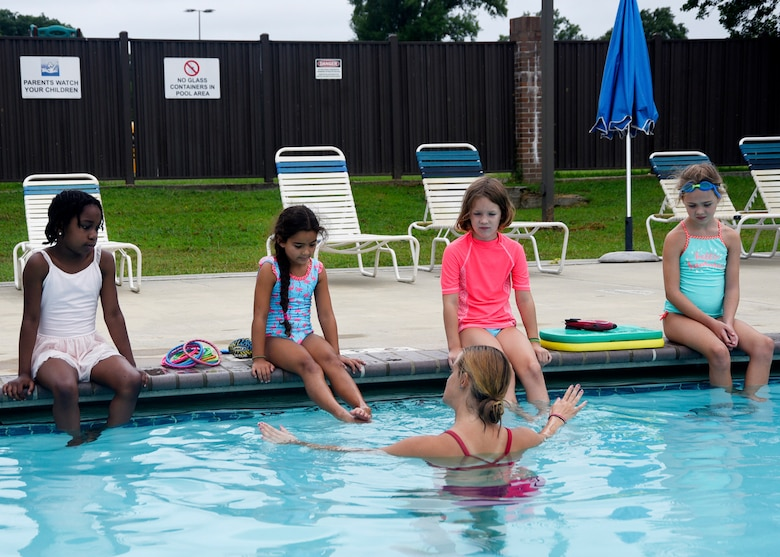 Eliza Shee, water safety instructor, teaches camp participants how to swim at Joint Base Andrews, Md., Aug. 21, 2018. During the four-day camp, kids learned a variety of skills from first responders, water safety instructors and camp counselors in and out of the pool. (U.S. Air Force photo by Senior Airman Abby L. Richardson)