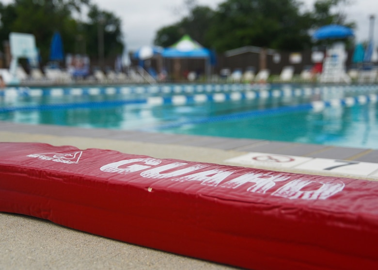 A lifeguard rescue tube is placed on the edge of the pool during the third annual water safety camp at Joint Base Andrews, Md., Aug. 21, 2018. During the camp, participants learned the basics of swimming and water safety. (U.S. Air Force photo by Senior Airman Abby L. Richardson)