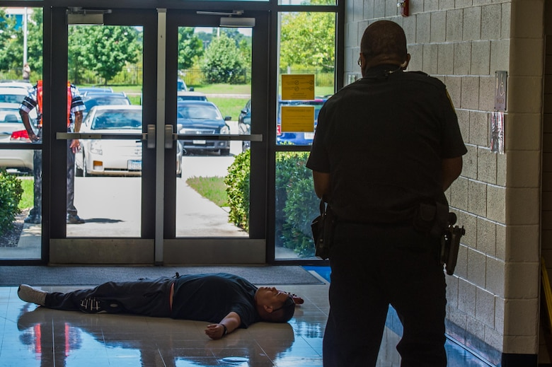 A 733rd Security Forces Squadron neutralizes a simulated active shooter during a school violence exercise at Joint Base Langley-Eustis, Virginia, Aug. 23, 2018.