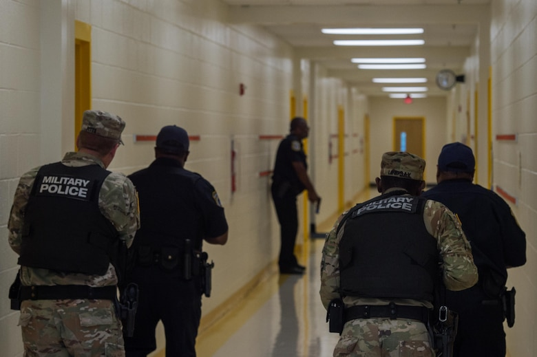 U.S. Army Soldiers and officers from the 733rd Security Forces Squadron clear rooms during a school violence exercise at Joint Base Langley-Eustis, Virginia, Aug. 23, 2018.