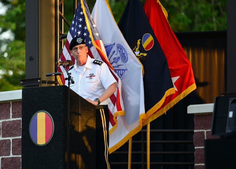 U.S. Army Lt. Gen. Theodore D. Martin, U.S. Army Training and Doctrine Command deputy commanding general, gives remarks during the TRADOC Band's 86th season finale of Music Under the Stars at Joint Base Langley-Eustis, Virginia, Aug. 23, 2018.