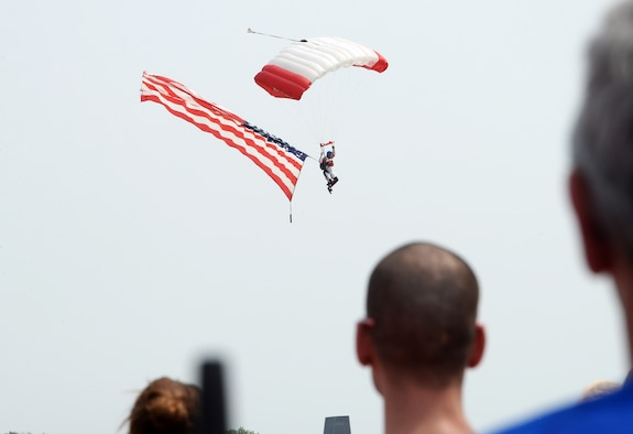 Michael Nugent, RE/MAX Skydiving Team, floats down to the ground while carrying the United States' flag during the 2018 Defenders of Freedom Air and Space Show Aug. 11, at Offutt Air Force Base, Nebraska.