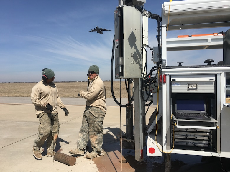 Members of the Air Force Civil Engineer Center's Airfield Pavement Evaluation Team perform structural testing at Altus Air Force Base, Oklahoma.