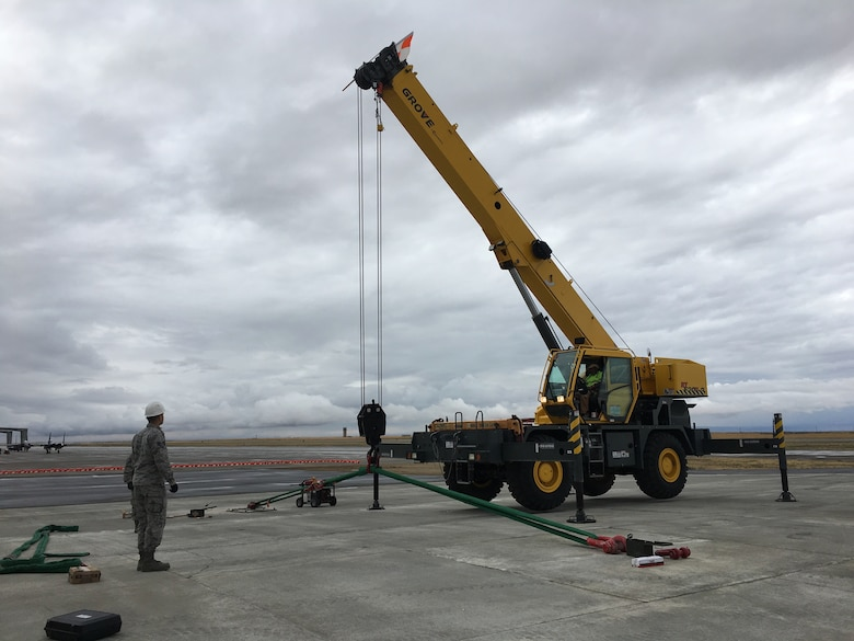 A member of the Airfield Pavement Evaluation Center conducts an anchor test on the airfield of Mountain Home Air Force Base, Idaho.
