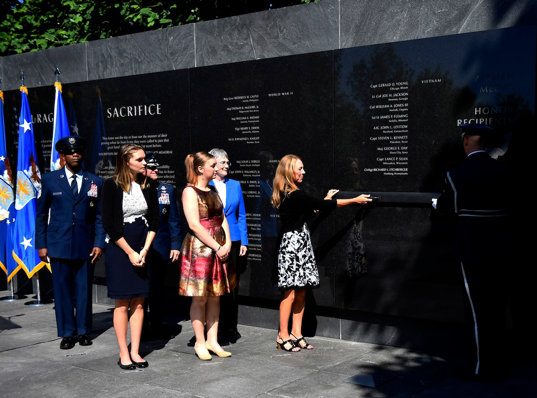 Valerie Nessel, widow of Master Sgt. John Chapman, along with daughters Brianna and Madison Chapman, Secretary of the Air Force Heather Wilson, Air Force Chief of Staff Gen. David L. Goldfein and Chief Master Sgt. of the Air Force Kaleth O. Wright unveil the name of Master Sgt. John Chapman during a ceremony at the Air Force Memorial in Arlington, Va., Aug. 24, 2018. Chapman was posthumously awarded the Medal of Honor for actions on Takur Ghar Mountain in Afghanistan March 4, 2002. An elite special operations team was ambushed by the enemy and came under heavy fire from multiple directions. Chapman immediately charged an enemy bunker through thigh-deep snow and killed all enemy occupants. Courageously moving from cover to assault a second machine gun bunker, he was injured by enemy fire. Despite severe wounds, he fought relentlessly, sustaining a violent engagement with multiple enemy personnel before making the ultimate sacrifice. With his last actions he saved the lives of his teammates. (U.S. Air Force photo by Staff Sgt. Rusty Frank)