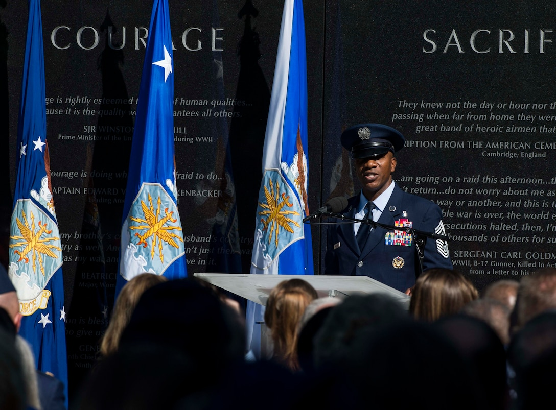 Chief Master Sgt. of the Air Force Kaleth O. Wright speaks during Master Sgt. John Chapman's name unveiling ceremony at the Air Force Memorial in Arlington, Va., Aug. 24, 2018. Chapman was posthumously awarded the Medal of Honor for actions on Takur Ghar Mountain in Afghanistan March 4, 2002. An elite special operations team was ambushed by the enemy and came under heavy fire from multiple directions. Chapman immediately charged an enemy bunker through thigh-deep snow and killed all enemy occupants. Courageously moving from cover to assault a second machine gun bunker, he was injured by enemy fire. Despite severe wounds, he fought relentlessly, sustaining a violent engagement with multiple enemy personnel before making the ultimate sacrifice. With his last actions he saved the lives of his teammates. (U.S. Air Force photo by Tech. Sgt. DeAndre Curtiss)