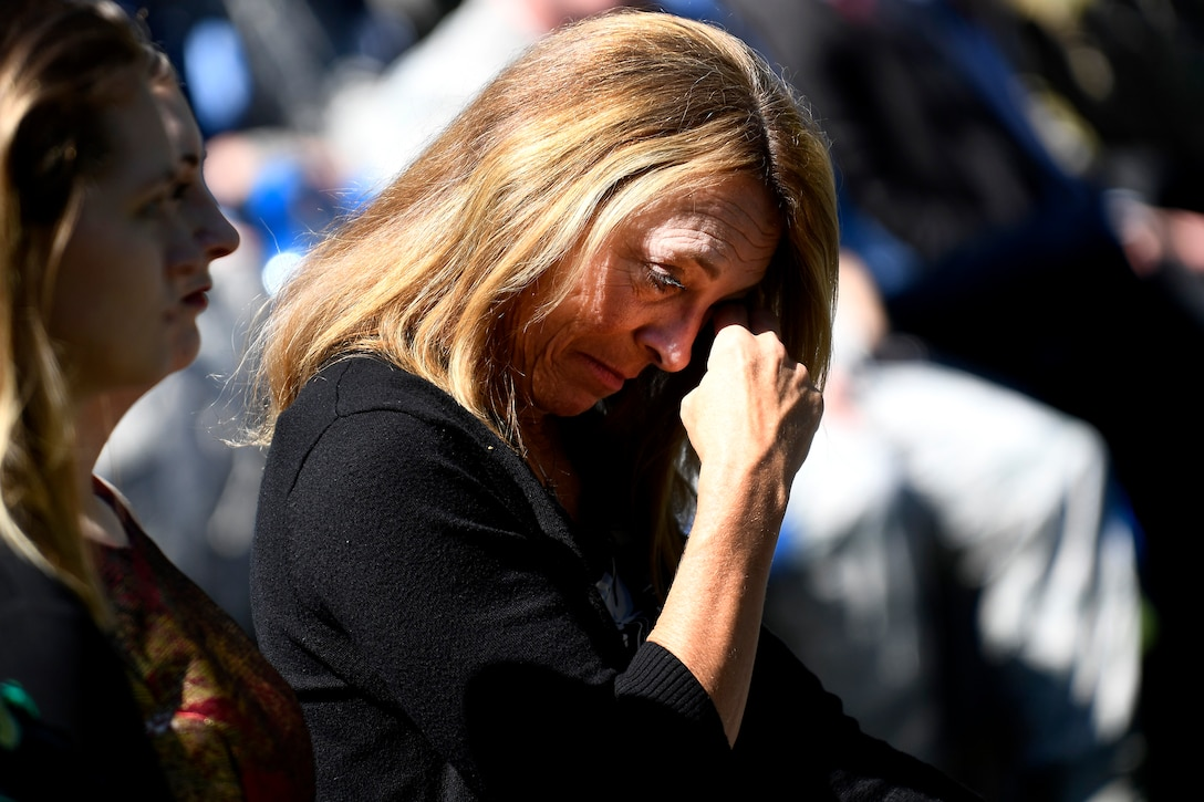 Valerie Nessel, widow of Master Sgt. John Chapman, attends Chapman's name unveiling ceremony at the Air Force Memorial in Arlington, Va., Aug. 24, 2018. Chapman was posthumously awarded the Medal of Honor for actions on Takur Ghar Mountain in Afghanistan March 4, 2002. An elite special operations team was ambushed by the enemy and came under heavy fire from multiple directions. Chapman immediately charged an enemy bunker through thigh-deep snow and killed all enemy occupants. Courageously moving from cover to assault a second machine gun bunker, he was injured by enemy fire. Despite severe wounds, he fought relentlessly, sustaining a violent engagement with multiple enemy personnel before making the ultimate sacrifice. With his last actions he saved the lives of his teammates. (U.S. Air Force photo by Staff Sgt. Rusty Frank)