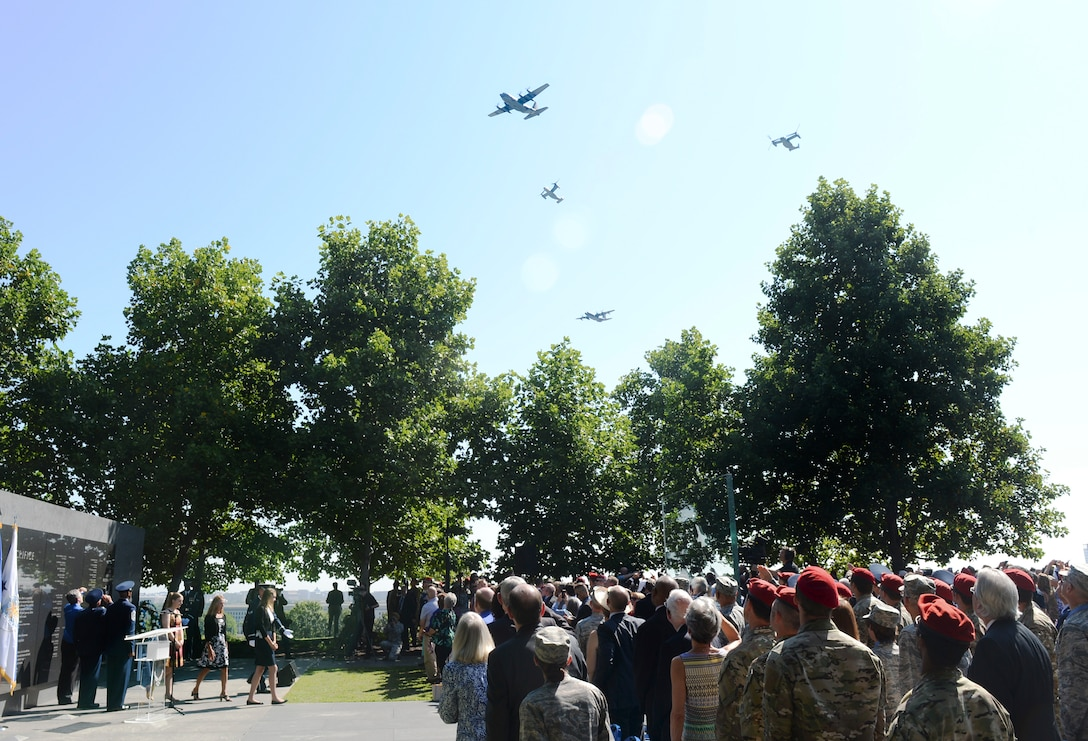A missing man formation flies over Master Sgt. John Chapman's name unveiling ceremony at the Air Force Memorial in Arlington, Va., Aug. 24, 2018. Chapman was posthumously awarded the Medal of Honor for actions on Takur Ghar Mountain in Afghanistan March 4, 2002. An elite special operations team was ambushed by the enemy and came under heavy fire from multiple directions. Chapman immediately charged an enemy bunker through thigh-deep snow and killed all enemy occupants. Courageously moving from cover to assault a second machine gun bunker, he was injured by enemy fire. Despite severe wounds, he fought relentlessly, sustaining a violent engagement with multiple enemy personnel before making the ultimate sacrifice. With his last actions he saved the lives of his teammates. (U.S. Air Force photo by Staff Sgt. Chad Trujillo)