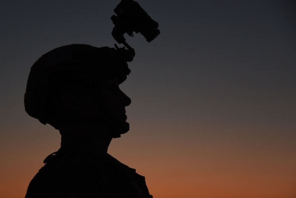 Capt. Eric Danko, with the 321st Contingency Response Squadron, prepares for a night air drop and C-130 Hercules landing during training at Camp Branch Landing Zone in Logan County, W.Va., Aug. 22, 2018. The 621st CRG spent four days training with and working alongside the 130th Air National Guard at Camp Branch practicing semi-prepared runway operations. (U.S. Air Force photo by Tech. Sgt. Jamie Powell)
