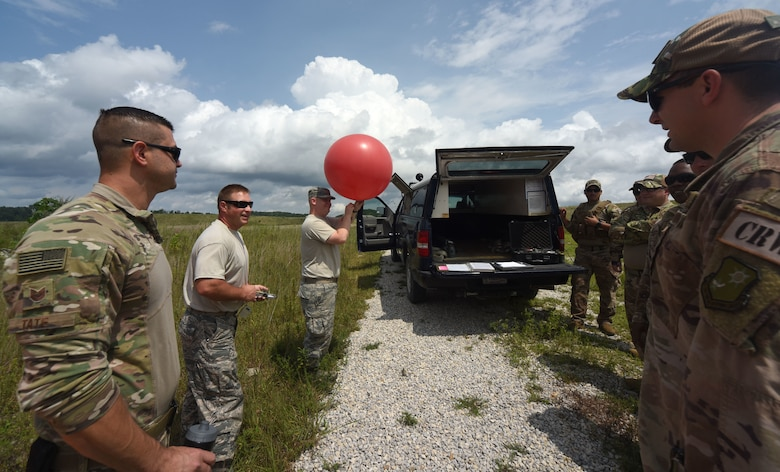 Air National Guard Airmen train 621st Contingency Response Airmen on weather balloons at Camp Branch in Logan County, W.Va., Aug. 21, 2018. The 621st CRG spent four days training with and working alongside the 130th ANG at Camp Branch practicing semi-prepared runway operations. (U.S. Air Force photo by Tech. Sgt. Jamie Powell)