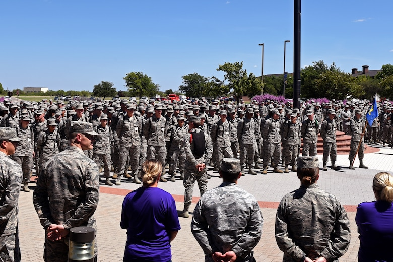 Goodfellow service members gather for a moment of silence and a group reciting of the Airman's Creed in honor of U.S. Air Force Master Sgt. John Chapman at the Norma Brown building on Goodfellow Air Force Base, Texas, Aug. 24, 2018. Chief Master Sgt. Jason Funkhauser, 315th Training Squadron chief enlisted manager, spoke on the events that lead to Chapman receiving the Medal of Honor. (U.S. Air Force photo by Airman 1st Class Zachary Chapman/Released)