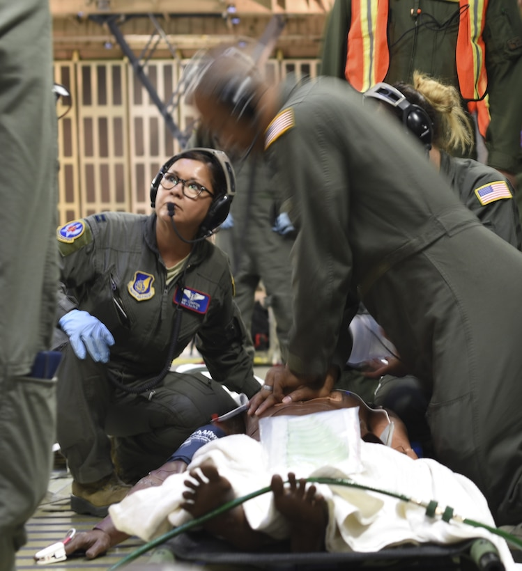 U.S. Air Force Staff Sgt. Jamal Wardlaw, 59th Medical Wing cardio pulmonary technician, center, performs cardio pulmonary resuscitation on a simulated patient during Exercise Ultimate Caduceus 2018 at Travis Air Force Base, California, Aug. 23, 2018. Ultimate Caduceus 2018 is an annual patient movement exercise designed to test the ability of U.S. Transportation Command to provide medical evacuation. (U.S. Air Force photo by Staff Sgt. Amber Carter)