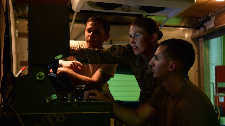 Tech. Sgt. Jacqueline Risley, 386th Expeditionary Civil Engineer Squadron, Explosive Ordnance Disposal equipment non-commissioned officer in charge, assists with the calibration of the unit's bomb robot Aug. 24, 2018, at an undisclosed location in Southwest Asia. Risley joined the nearly all-male EOD career field to fulfill her desire to constantly be challenged. (U.S. Air Force photo by Staff Sgt. Christopher Stoltz)