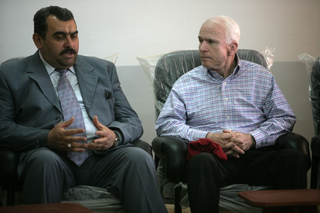 Arizona Sen. John S. McCain meets with Mamoun Sami Rasheed Al Awani, governor of Al Anbar in Haditha, Iraq, March 16, 2008. McCain asked questions about the Anbar Awakening as well as the economy in Haditha during his discussions. Courtesy photo