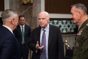 Sen. John McCain greets Secretary of Defense Jim Mattis and U.S. Marine Corps Gen. Joseph F. Dunford, Jr., chairman of the Joint Chiefs of Staff, before a Senate Armed Services Committee hearing on Capitol Hill, Oct. 3, 2017. Mattis and Dunford testified about the political and security situation in Afghanistan.