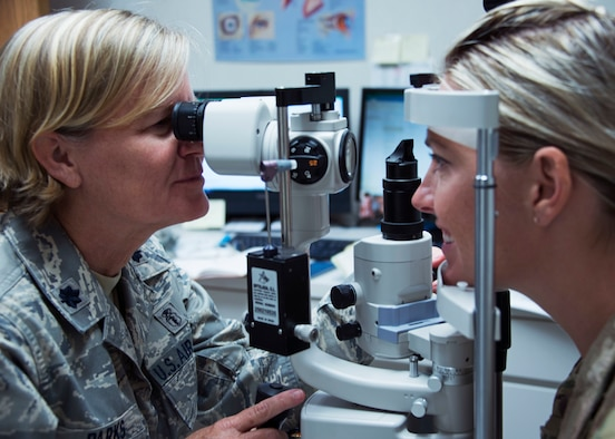 Lt. Col. Kelli Parks, an optometrist with the 919th Special Operations Medical Squadron, performs an eye exam on a fellow Air Force reservist Aug. 5, 2018 at Hurlburt Field, Fla.