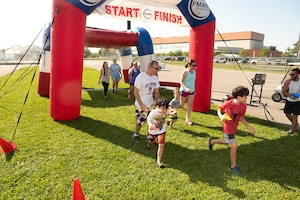 Associates and families beat the heat during 5K