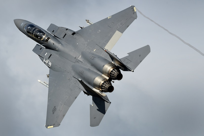 An F-15E Strike Eagle assigned to the 492nd Fighter Squadron flies over Royal Air Force Lakenheath, England, Aug. 17. The 492nd dedicated F-15E Strike Eagles in support of Typhoon Warrior, the Royal Air Force's premier air combat training exercise during the month of August. (U.S. Air Force photo/ Tech. Sgt. Matthew Plew)