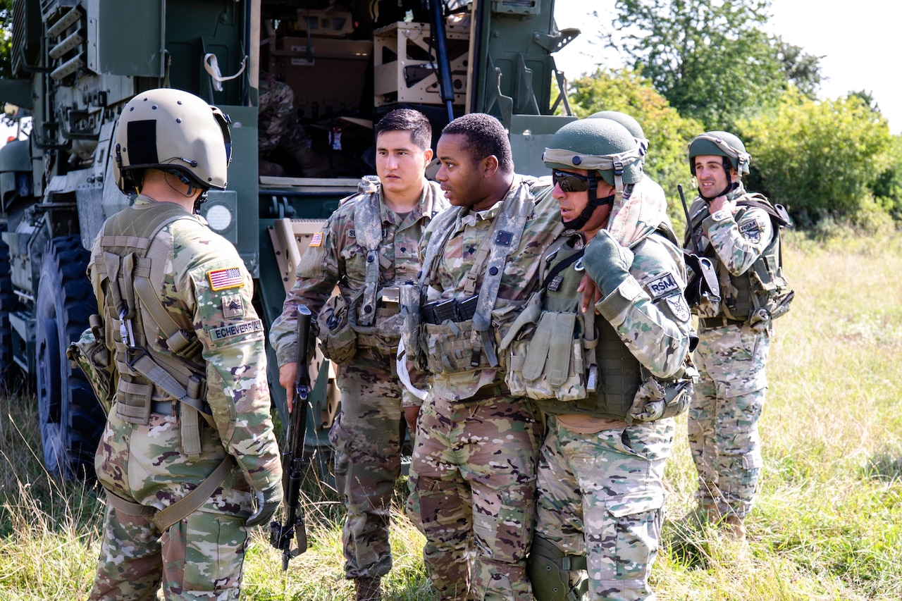 Army Sgt. Rodolfo Echeverria, left, a flight medic with Charlie Company, 2nd General Support Aviation Battalion, directs U.S. and Georgian soldiers during a medical evacuation training exercise at Hohenfels Training Area, Germany, Aug. 21, 2018. Army photo by Pfc. Matthew J. Marcellus