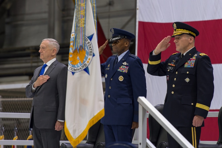 U.S. Secretary of Defense James N. Mattis (left), U.S. Air Force Gen. Darren W. McDew (center) and U.S. Army Gen. Stephen R. Lyons (right) pay respect to the colors during a U.S. Transportation Command change of command ceremony at Scott Air Force Base, Illinois, Aug. 24, 2018.