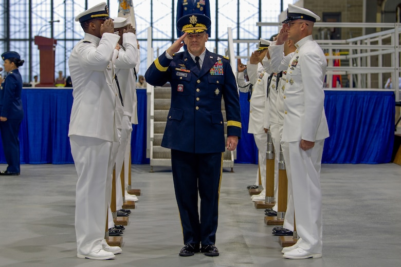 U.S. Army Gen. Stephen R. Lyons salutes a detail of sailors after taking command of U.S. Transportation Command during a ceremony held at Scott Air Force Base, Illinois, Aug. 24, 2018.