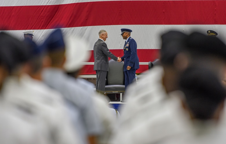 U.S. Secretary of Defense James N. Mattis congratulates retiring U.S. Air Force Gen. Darren W. McDew during the U.S. Transportation Command change of command ceremony, Aug. 24, 2018, at Scott Air Force Base, Illinois.