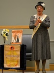 American Historical Theatre actress Pat Jordan portrays women's suffragist Carrie Chapman Catt during a DLA Troop Support Women's Equality Day Aug. 23. 2018. Women's Equality Day commemorates the 19th Amendment to the U.S. Constitution, which granted women the right to vote in 1920.