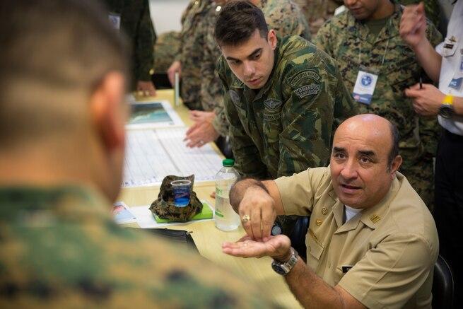 An Ecuador Navy Captain talks to a U.S. Marine