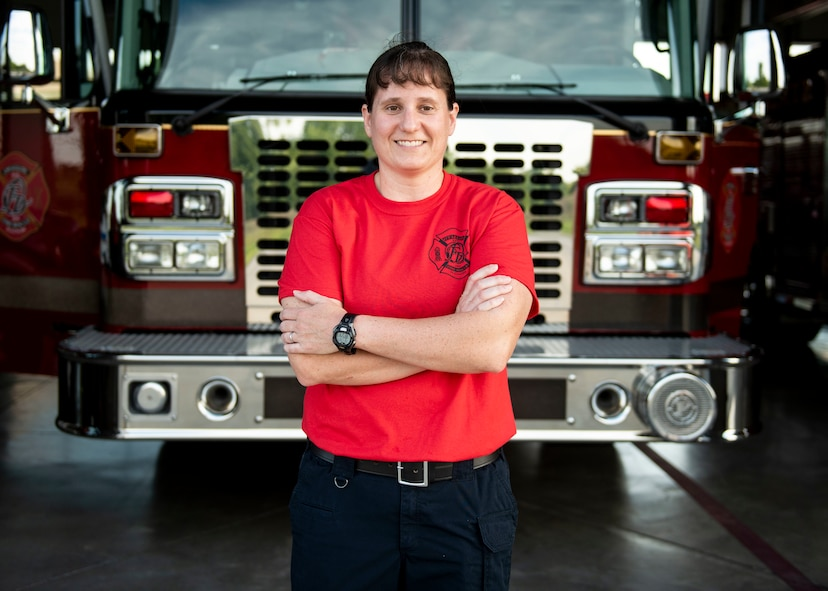 """U.S. Army Maj. Nikki Blystone, U.S. Transportation Command logistics officer, stands in front of a fire engine, July 7, 2017, at the O'Fallon Fire Department in O'Fallon, Illinois. Blystone said some of the best moments come from educating young girls about being a firefighter: """"I see some of the little girls that come up when we do a truck display and ask them, """"Are you going to be a firefighter?' and the look in their eyes is 'Oh, I can do that?' I hope one day that's not a question."""""""