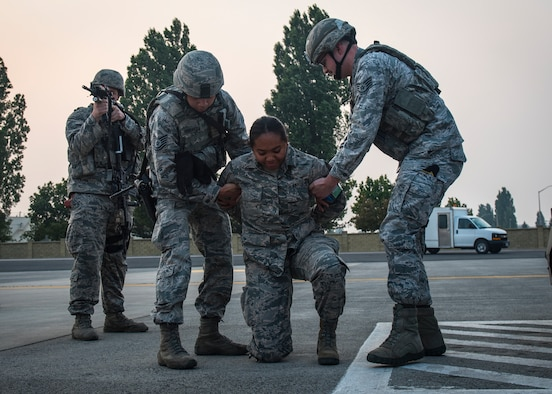92nd Security Forces Squadron Airmen practice arresting procedures during a Titan Fury exercise at Fairchild Air Force Base, Washington, Aug. 20, 2018. All base facets played critical roles during the exercise to enhance interoperability as a total force. Titan Fury is a readiness exercise used to validate and enhance Fairchild Airmen's ability to provide Rapid Global Mobility as required by the U.S. Strategic Command and U.S. Transportation Command. (U.S. Air Force photo/Airman 1st Class Whitney Laine)