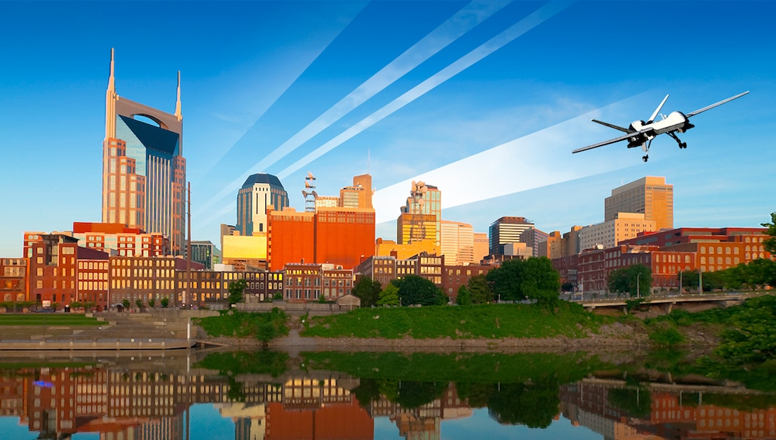 Nashville downtown skyline at dawn with the Cumberland River in the foreground.