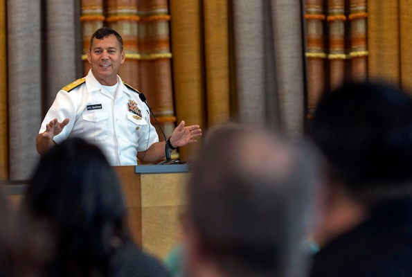 Rear Adm. Stephen Williamson, the Naval Sea Systems Command deputy commander for logistics, maintenance, and industrial operations, addresses attendees at the command's Lean Six Sigma Black Belt graduation ceremony Aug. 24 at the Norm Dicks Government Center in Bremerton, Wash
