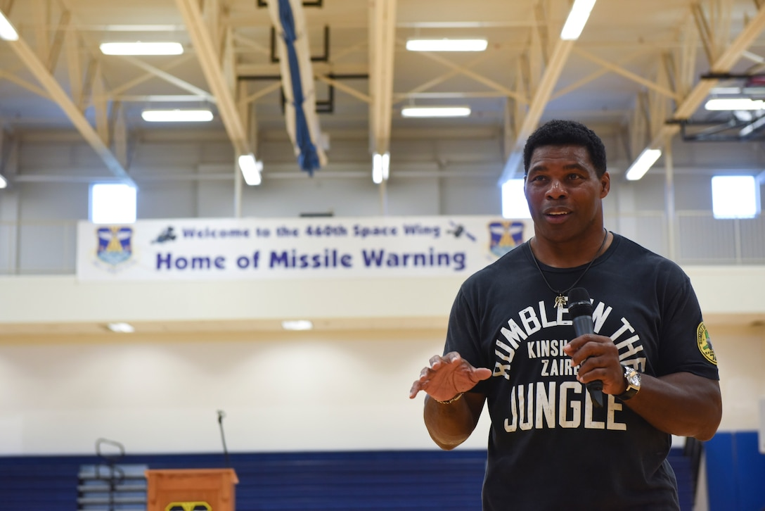 Herschel Walker, college football hall-of-fame star, speaks with Team Buckley Airmen Aug. 15, 2018, on Buckley Air Force Base, Colorado. Walker has visited over 300 bases to discuss his personal experiences to help service-members battle mental illness. (U.S. Air Force photo by Airman 1st Class Michael D. Mathews)