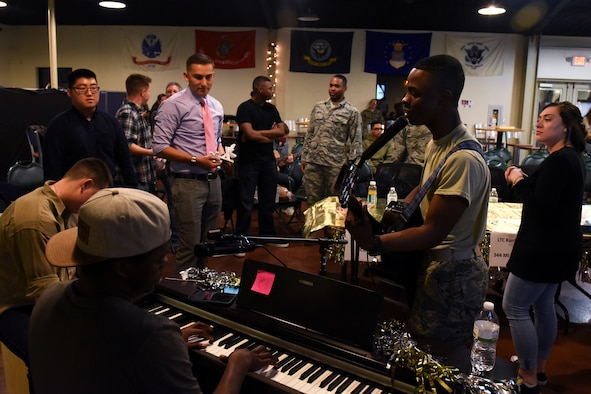 Members of Goodfellow Air Force Base play music together on a break during a talent show at the Crossroads on Goodfellow AFB, Texas, Feb. 16, 2018. Talent shows are just one of the many events for members to come together. (U.S. Air Force photo by Airman 1st Class Zachary Chapman/Released)