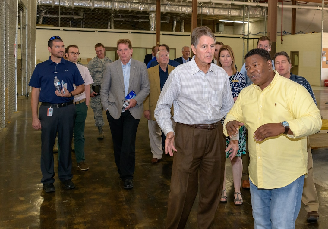 Mr. Mark Pollock, Vectrus supply manager, leads a facility tour during the 81st Mission Support Group Honorary Commanders tour at the Taylor Logistics Center at Keesler Air Force Base, Mississippi, Aug. 23, 2018. The honorary commander program is a partnership between base leadership and local civic leaders to promote strong ties between military and civilian leaders. (U.S. Air Force Photo by Andre' Askew)